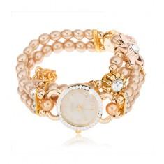 Zegarek na rękę, cyferblat z cyrkoniami, bransoletka z koralików złotego koloru, kwiaty