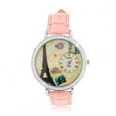 Zegarek z paskiem łososiowego koloru, duży cyferblat z cyrkoniami, wieża Eiffla
