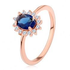Srebrny pierścionek miedzianego koloru, ciemnoniebieska owalna cyrkonia w przezroczystej oprawie