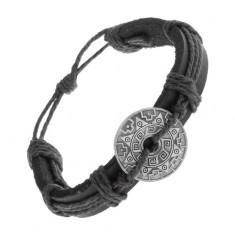 Bransoletka z czarnej syntetycznej skóry i sznurków, okrąg ze wzorami i wycięciem