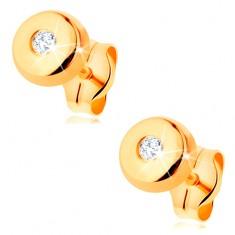 Złote kolczyki 585 - małe lśniące kółko z bezbarwną cyrkonią pośrodku