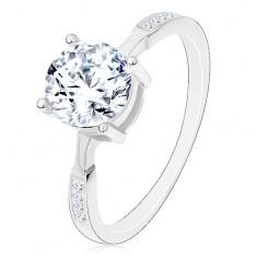 Srebrny pierścionek 925, okrągła cyrkonia bezbarwnego koloru, cyrkonie na ramionach