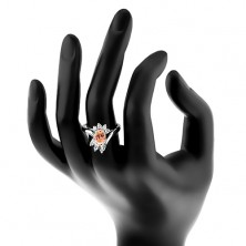 Pierścionek srebrnego koloru, duża owalna cyrkonia, prostokątne i okrągłe cyrkonie