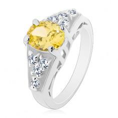 Pierścionek srebrnego koloru, zielono-żółta owalna cyrkonia, kwadraty bezbarwnych cyrkonii