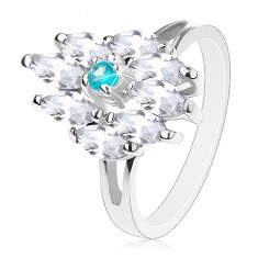 Pierścionek srebrnego koloru, akwamarynowo niebieski środek i bezbarwne ziarnka