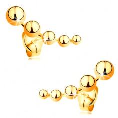 Kolczyki wkręty z żółtego złota 585 - zmniejszające się kuleczki