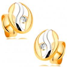 Diamentowe kolczyki z 14K złota - zarys owalu z falą z białego złota, brylant