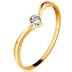 Pierścionek z żółtego złota 585 - lśniące zagięte ramiona, błyszczący przezroczysty diament