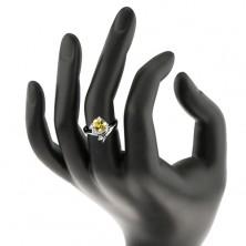 Błyszczący pierścionek w srebrnym odcieniu, owalna cyrkonia żółtego koloru