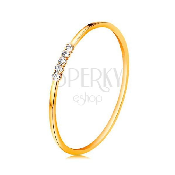 Pierścionek z żółtego 585 złota - linia bezbarwnych cyrkonii, cienkie lśniące ramiona