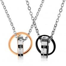 Dwa stalowe naszyjniki, dwukolorowe połączone pierścienie, napisy, cyrkonie