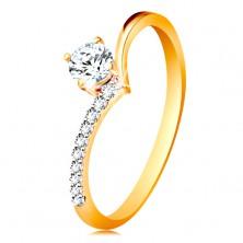 Złoty pierścionek 585 - ramiona zagięte w szpic i cyrkonia bezbarwnego koloru w koszyczku