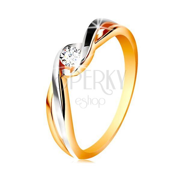 Złoty pierścionek 585 - dwukolorowe, rozdzielone i faliste ramiona, bezbarwna cyrkonia