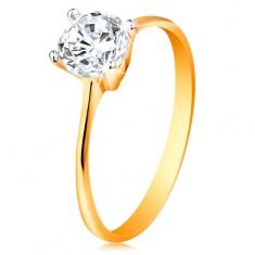 Złoty pierścionek 585 - zwężone ramiona, błyszcząca bezbarwna cyrkonia w lśniącym koszyczku