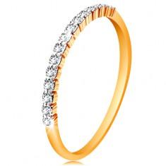 Złoty 585 pierścionek - pas błyszczących bezbarwnych cyrkonii, lśniące ramiona