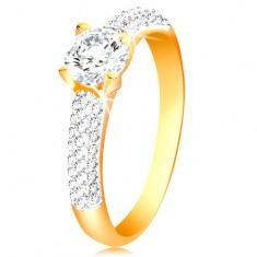 Złoty 14K pierścionek - lśniące ramiona, podniesiony okrągły cyrkon bezbarwnego koloru