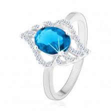 Srebrny pierścionek 925, kontur przezroczystego liścia z owalną jasnoniebieską cyrkonią