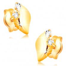Diamentowe kolczyki wykonane z żółtego 14K złota - dwa bezbarwne brylanty, błyszczący listek