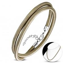 Naszyjnik owinięty błyszczącą nicią złoto-brązowego koloru, karabińczyk