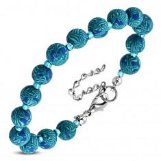 Niebieska bransoletka, większe wzorzyste kulki FIMO i małe przezroczyste koraliki