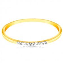 Złoty 14K pierścionek - cienkie błyszczące ramiona, lśniąca bezbarwna cyrkoniowa linia
