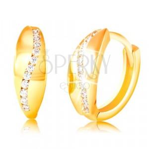 Złote 14K kolczyki - błyszczący zakrzywiony pas z bezbarwnych cyrkonii