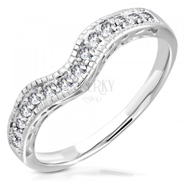 Stalowy pierścionek o srebrnym kolorze - pofalowana linia inkrustowana cyrkoniami
