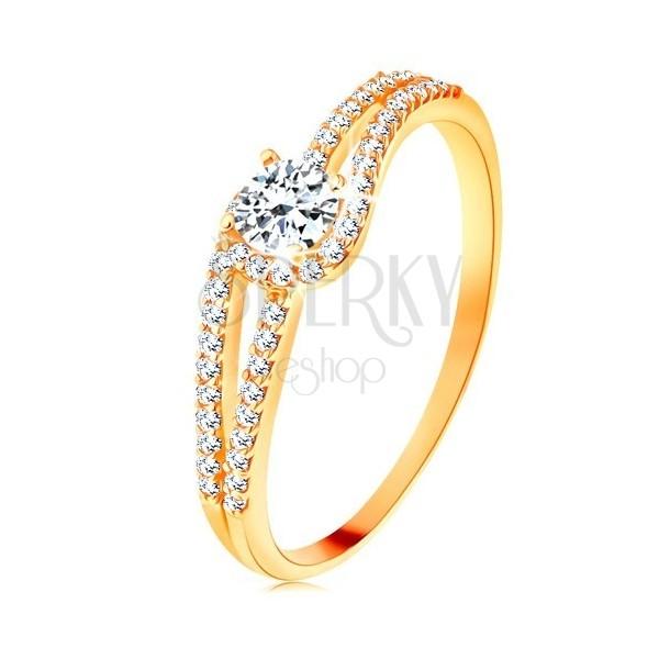 Złoty pierścionek 375 z rozdzielonymi błyszczącymi ramionami, przezroczysta cyrkonia
