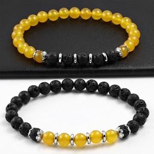 Zestaw dwóch elastycznych bransoletek - czarne i pomarańczowo-żółte kuleczki, motyw kwiatowy