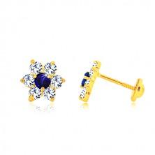Złote kolczyki 585 - przezroczysty cyrkoniowy kwiat z szafirowo-niebieskim środkiem, sztyfty z gwintem