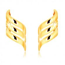 Kolczyki z żółtego złota 375, sztyfty - trzy błyszczące, spiralnie skręcone wstążki