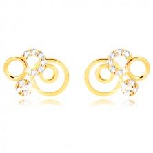 Kolczyki z żółtego złota 375 - pierścienie i błyszczące przezroczyste cyrkonie