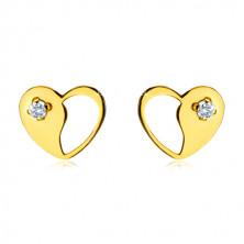 Złote kolczyki wkrętki 585 - regularne serce z ozdobnym wycięciem i przezroczystą cyrkonią