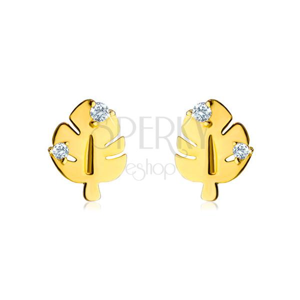 Złote kolczyki 585 - błyszczący liść z wycięciami i trzonkiem, dwie przezroczyste cyrkonie