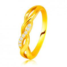 Lśniący pierścionek z żółtego 14K złota - przeplatające się fale, brylantowa linia