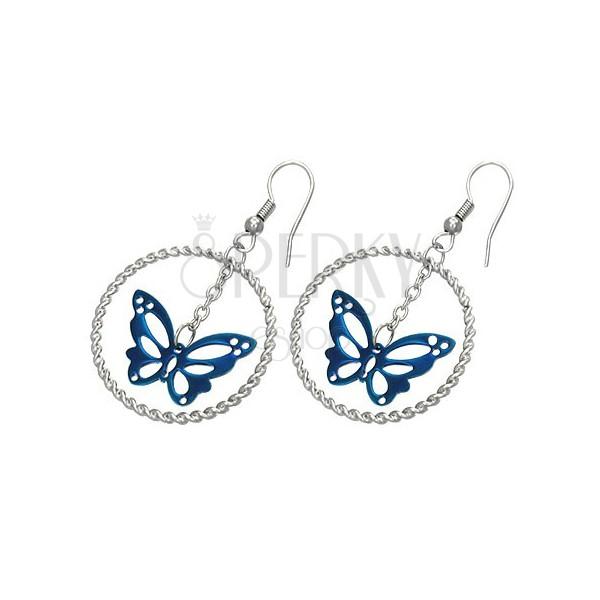 Stalowe kolczyki srebrnego koloru, niebieski motyl w kółku, bigle